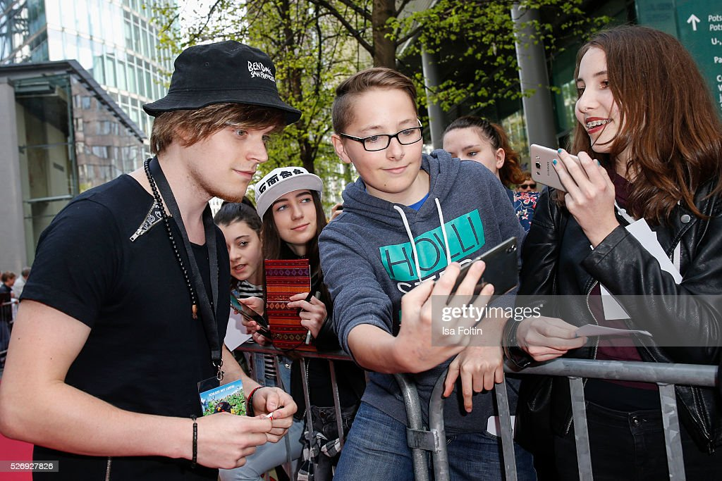 Youtube star Viktor aka iBlali with fans during the Berlin premiere of the film 'Angry Birds - Der Film' at CineStar on May 1, 2016 in Berlin, Germany.