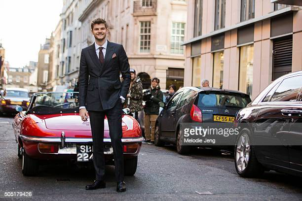Youtuber Jim Chapman arrives at the Richard James show in a red 1969 EType Jaguar and wears a Dunhill London suit during The London Collections Men...