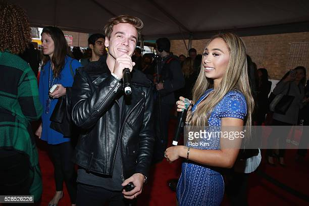 YouTubers Joe Sugg and Eva Gutowski pose for a photo during YouTube Brandcast presented by Google on May 5 2016 in New York City