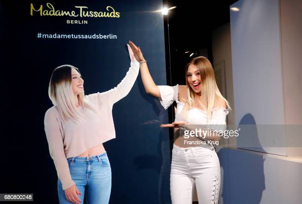 YoutubeStar Bianca 'Bibi' Heinicke poses next to a hologram of her at Madame Tussauds on May 9 2017 in Berlin Germany Bibi's hologram is the first of...