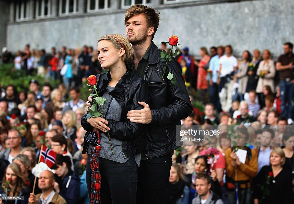 A youung couple hold roses, part of an estimated 100,000 people gather in Oslo town centre for a vigil following Friday's twin extremist attacks on July 25, 2011 in Oslo, Norway. Anders Behring Breivik, 32, claimed that he has 'two more cells' working with him as he appeared in court today following a bomb blast at a government building in Oslo and a shooting massacre on nearby Utoya Island that killed at least 76 people in all. The death toll was originally reported as 93. Breivik has been detained for eight weeks, four of which in full isolation.