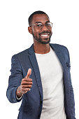 Studio shot of a young businessman showing a thumbs up gesture against a white background
