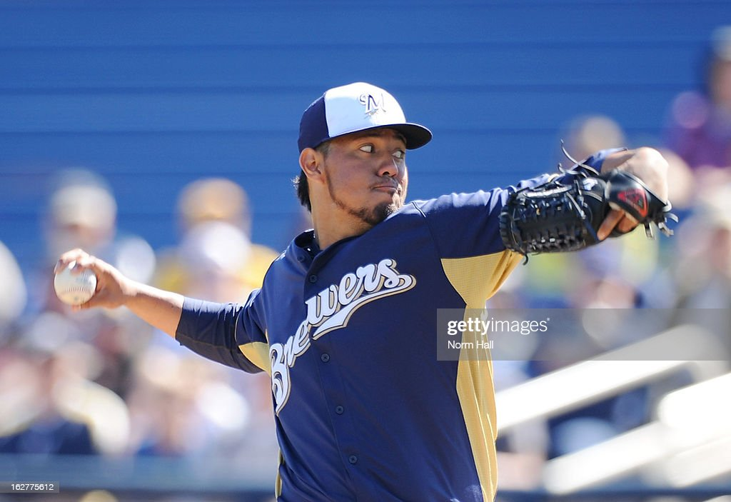<a gi-track='captionPersonalityLinkClicked' href=/galleries/search?phrase=Yovani+Gallardo&family=editorial&specificpeople=757367 ng-click='$event.stopPropagation()'>Yovani Gallardo</a> #49 of the Milwaukee Brewers delivers a pitch against the Seattle Mariners at Maryvale Baseball Park on February 26, 2013 in Maryvale, Arizona.