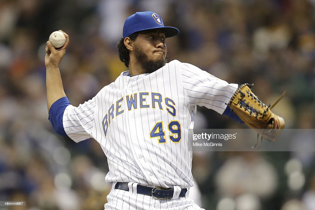 Yovani Gallardo #49 of the Milwaukee Brewers pitches during the top of the first inning against the Pittsburgh Pirates at Miller Park on April 12, 2014 in Milwaukee, Wisconsin.