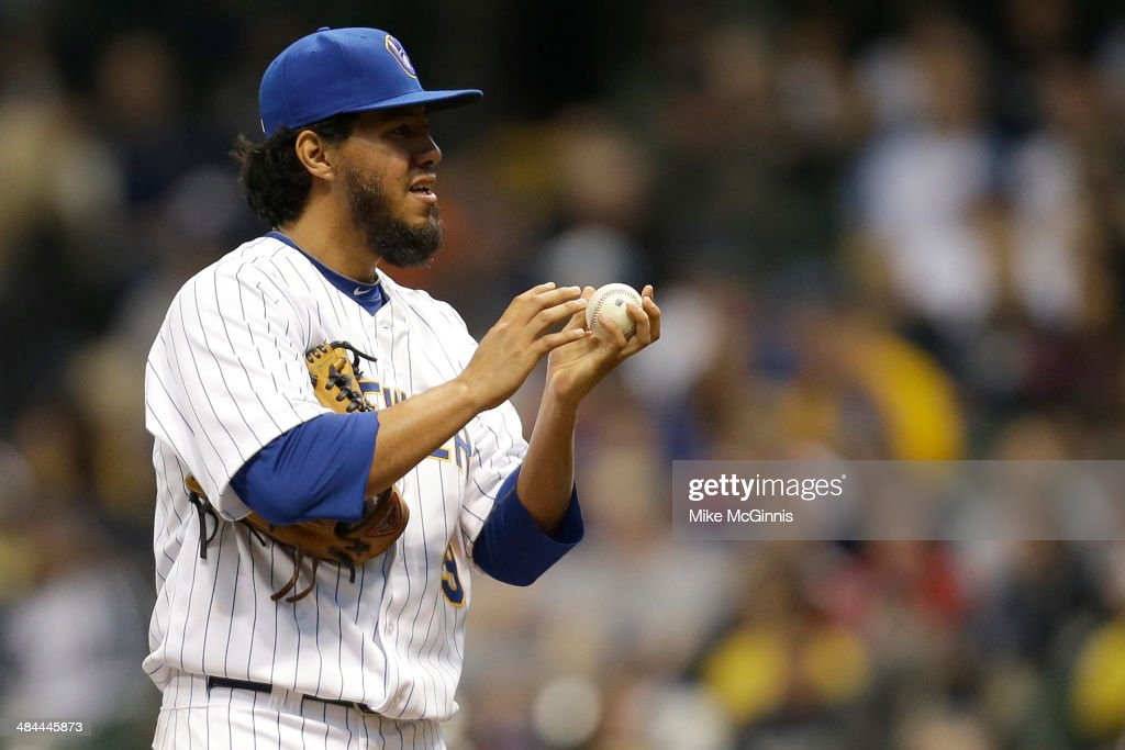 Yovani Gallardo #49 of the Milwaukee Brewers pitches during the top of the second inning against the Pittsburgh Pirates at Miller Park on April 12, 2014 in Milwaukee, Wisconsin.