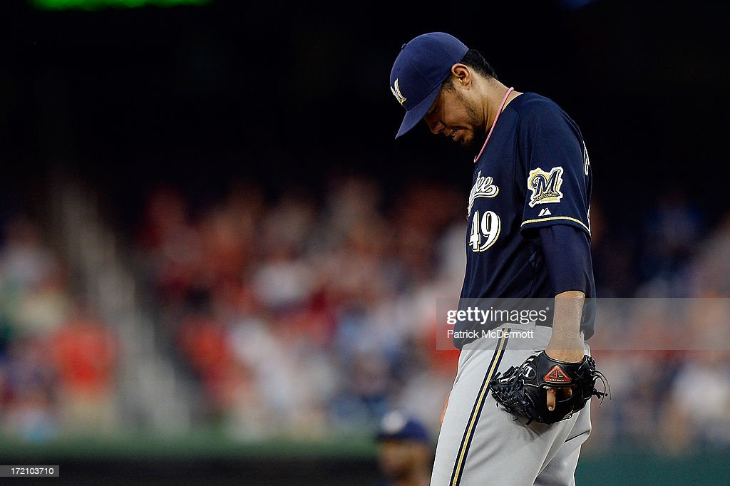 <a gi-track='captionPersonalityLinkClicked' href=/galleries/search?phrase=Yovani+Gallardo&family=editorial&specificpeople=757367 ng-click='$event.stopPropagation()'>Yovani Gallardo</a> #49 of the Milwaukee Brewers reacts as Ron Roenicke #10 walks to the pitcher's mound to pull him in the fourth inning during a game against the Washington Nationals at Nationals Park on July 1, 2013 in Washington, DC.