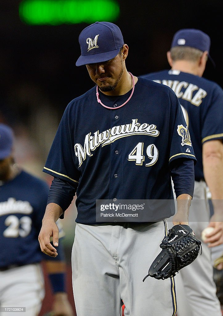 <a gi-track='captionPersonalityLinkClicked' href=/galleries/search?phrase=Yovani+Gallardo&family=editorial&specificpeople=757367 ng-click='$event.stopPropagation()'>Yovani Gallardo</a> #49 of the Milwaukee Brewers walks to the dugout after being pulled in the fourth inning during a game against the Washington Nationals at Nationals Park on July 1, 2013 in Washington, DC.