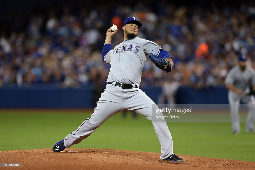 Yovani Gallardo of the Texas Rangers throws a pitch in the first inning against the Toronto Blue Jays during game one of the American League Division...