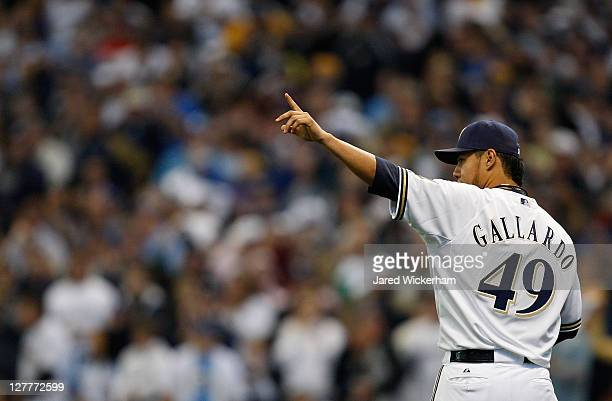 Yovanni Gallardo of the Milwaukee Brewers signals to his left fielder Ryan Braun after throwing out Willie Bloomquist of the Arizona Diamondbacks at...