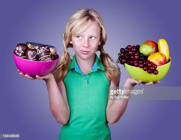 Yoyng girl holding bowls