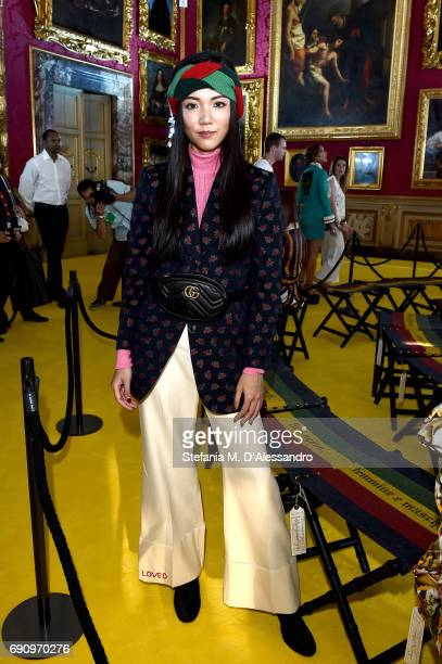 Yoyo Cao attends the Gucci Cruise 2018 fashion show at Palazzo Pitti on May 29 2017 in Florence Italy