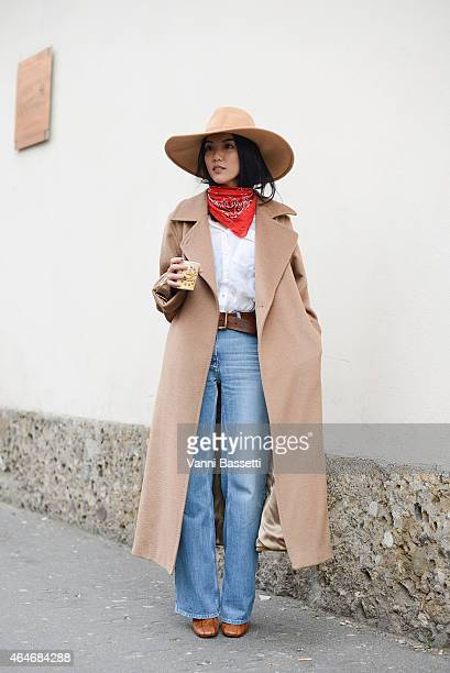 Yoyo Cao poses before the Tod's show during Milan Fashion Week on February 27 2015 in Milan Italy