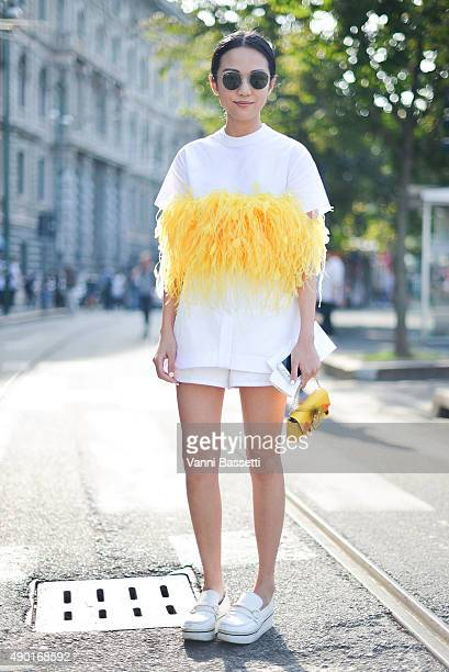 Yoyo Cao poses wearing a Dsquared dress before the Jil Sander show during the Milan Fashion Week Spring/Summer 16 on September 26 2015 in Milan Italy