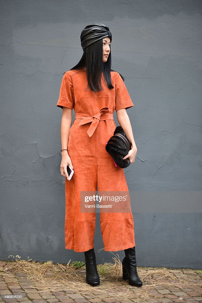 Yoyo Cao poses wearing a vintage dress before the MSGM show during the Milan Fashion Week Spring/Summer 16 on September 27 2015 in Milan Italy