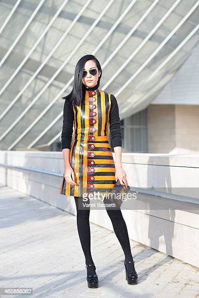 Yoyo Cao poses wearing Louis Vuitton dress and bag and St Laurent shoes on Day 9 of Paris Fashion Week Womenswear FW15 on March 11 2015 in Paris...