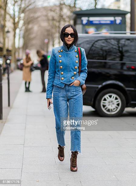 Yoyo Cao wearing a denim jacket and jeans and Gucci bag outside Balmain during the Paris Fashion Week Womenswear Fall/Winter 2016/2017 on March 3...