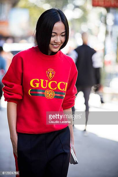 Yoyo Cao wearing a Gucci sweater at Hermes show on day 7 of Paris Womens Fashion Week Spring/Summer 2017 on October 3 2016 in Paris France