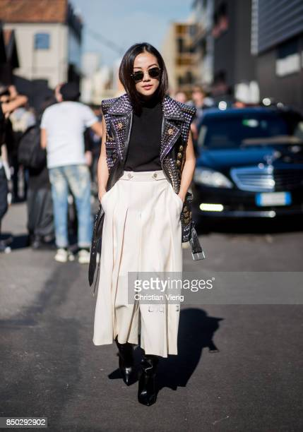 Yoyo Cao wearing a leather vest maxi skirt is seen outside Gucci during Milan Fashion Week Spring/Summer 2018 on September 20 2017 in Milan Italy
