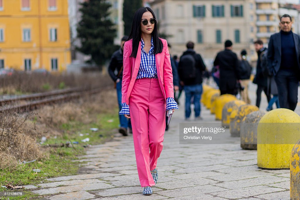 Yoyo Cao wearing a pink Gucci suit and blue white plaid shirt and shoes seen outside Gucci during Milan Fashion Week Fall/Winter 2016/17 on February...