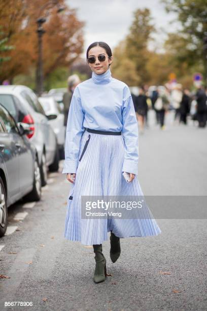 Yoyo Cao wearing blue top and skirt seen outside Sacai during Paris Fashion Week Spring/Summer 2018 on October 2 2017 in Paris France