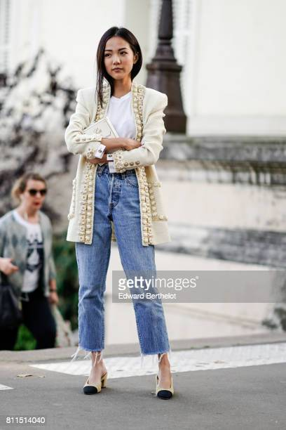 Yoyo Cao wears a Chanel white tweed jacket a white top blue cropped jeans Chanel shoes outside the launch party for Chanel's new perfume 'Gabrielle'...