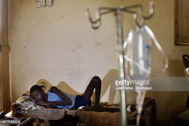 A 14 yr old boyinjured in his two legs from the bombing of his village in the Bunj clinic which cares for people from Doro refugee camp in BunjMaban...