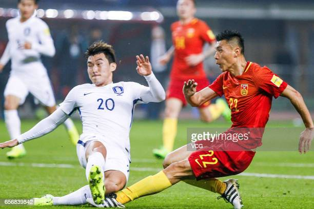 Yu Dabao of China and Jang Hyunsoo of South Korea vie for the ball during the 2018 FIFA World Cup Qualifying group match between China and South...