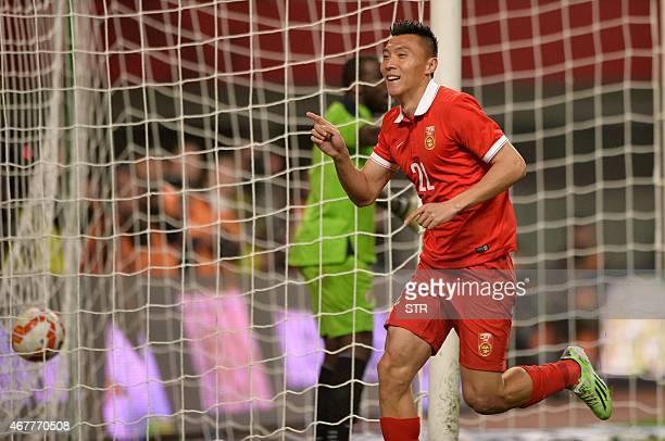 Yu Dabao of China national football team celebrates a goal during their match against Haiti national football team in Helong stadium in Changsha...