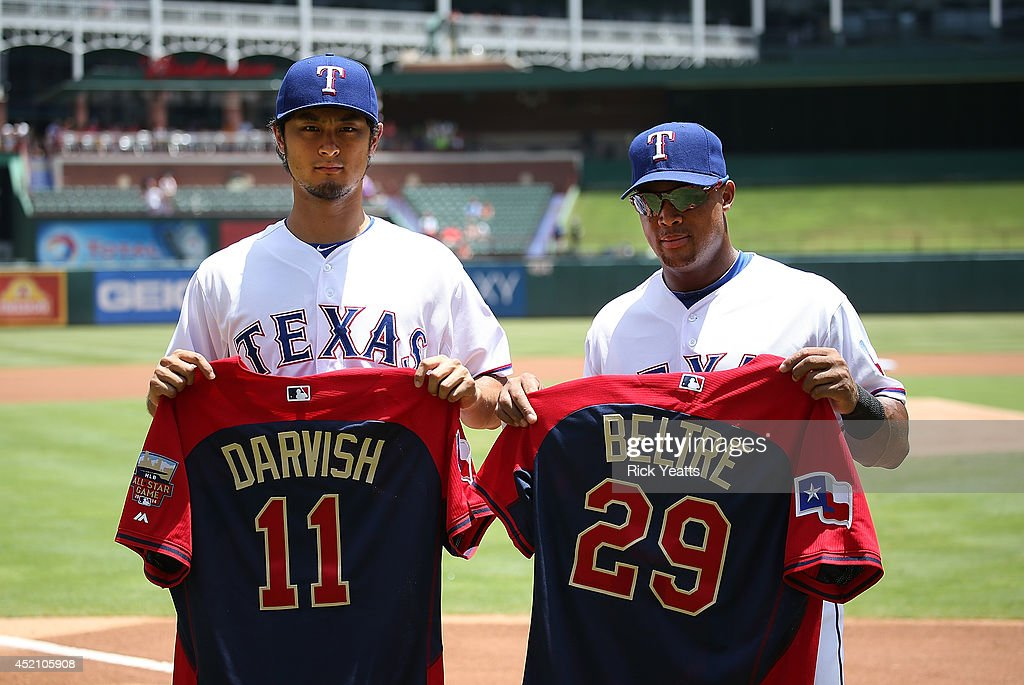 <a gi-track='captionPersonalityLinkClicked' href=/galleries/search?phrase=Yu+Darvish&family=editorial&specificpeople=4018539 ng-click='$event.stopPropagation()'>Yu Darvish</a> #11and <a gi-track='captionPersonalityLinkClicked' href=/galleries/search?phrase=Adrian+Beltre&family=editorial&specificpeople=202631 ng-click='$event.stopPropagation()'>Adrian Beltre</a> #29 of the Texas Rangers receive their All Star Jerseys for the up coming MLB All Star Game before the start of the game against the Los Angeles Angels of Anaheim at Globe Life Park in Arlington on July 13, 2014 in Arlington, Texas.