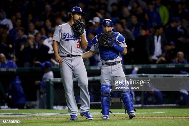 Yu Darvish and Austin Barnes of the Los Angeles Dodgers meet in the seventh inning against the Chicago Cubs during game three of the National League...