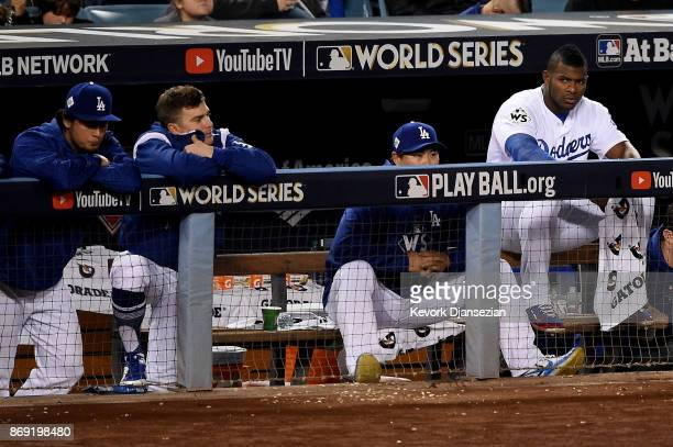 Yu Darvish Enrique Hernandez Hyunjin Ryu and Yasiel Puig of the Los Angeles Dodgers watch from the top step against the Houston Astros in game seven...