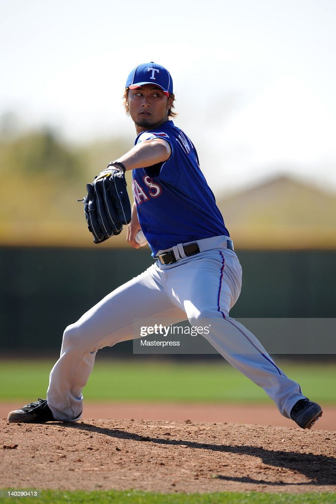 Yu Darvish of Texas Rangers throws during the Texas Rangers spring training at Surprise Stadium on February 25 2012 in Surprise Arizona
