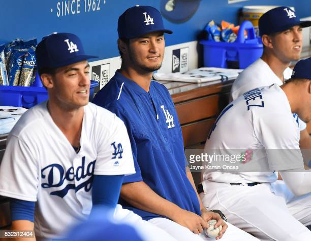 Yu Darvish of the Los Angeles Dodgers and Cody Bellinger of the Los Angeles Dodgers in the dugout before the start of the game against the Chicago...