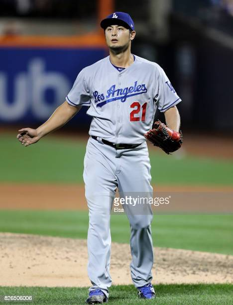 Yu Darvish of the Los Angeles Dodgers celebrates the last out of the seventh inning against the New York Mets on August 4 2017 at Citi Field in the...