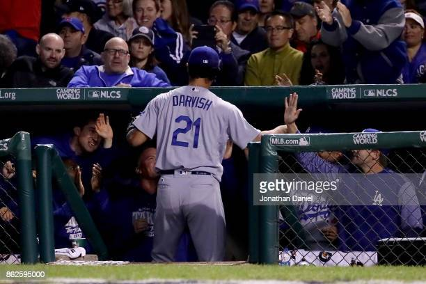 Yu Darvish of the Los Angeles Dodgers celebrates with teammates after being relieved in the seventh inning against the Chicago Cubs during game three...