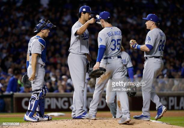 Yu Darvish of the Los Angeles Dodgers celebrates with teammates before being relieved in the seventh inning against the Chicago Cubs during game...