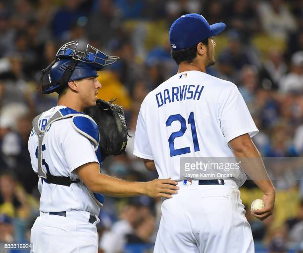 Yu Darvish of the Los Angeles Dodgers gets some encouragement from Austin Barnes of the Los Angeles Dodgers in the fifth inning of the game against...