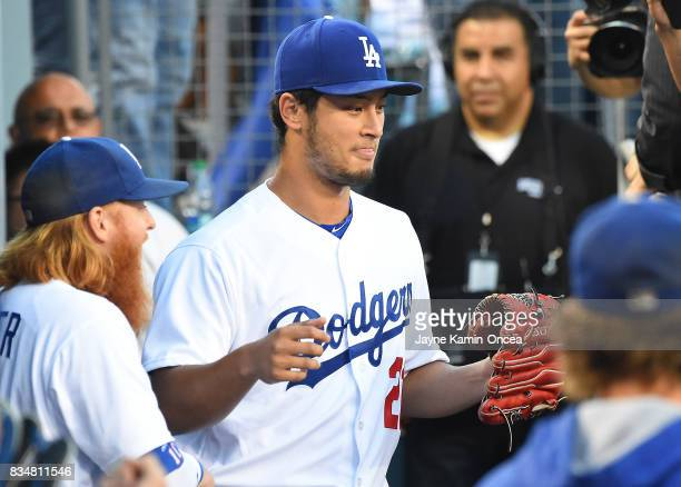 Yu Darvish of the Los Angeles Dodgers heads on to the field from the dugout to start the game against the Chicago White Sox on August 16 2017 in Los...