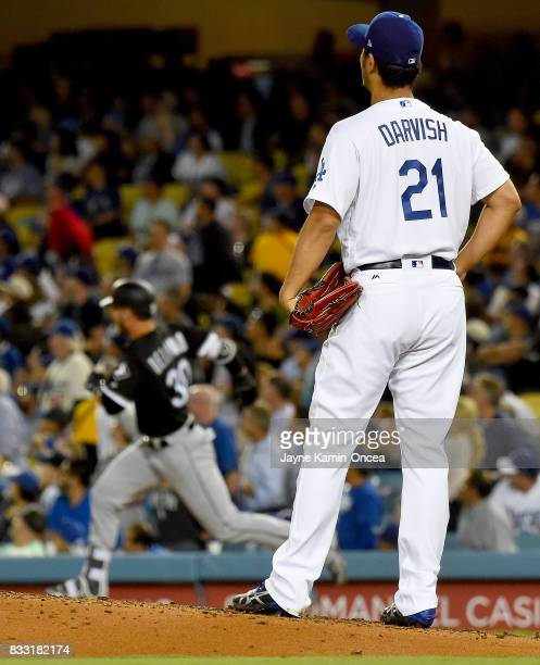 Yu Darvish of the Los Angeles Dodgers looks on as Nicky Delmonico of the Chicago White Sox rounds the bases after a solo home run in the fourth...