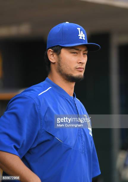 Yu Darvish of the Los Angeles Dodgers looks on from the dugout during the seventh inning of the game against the Detroit Tigers at Comerica Park on...
