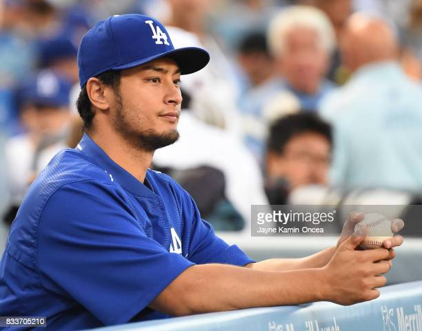 Yu Darvish of the Los Angeles Dodgers looks out from the dugout during the game against the Chicago White Sox at Dodger Stadium on August 15 2017 in...