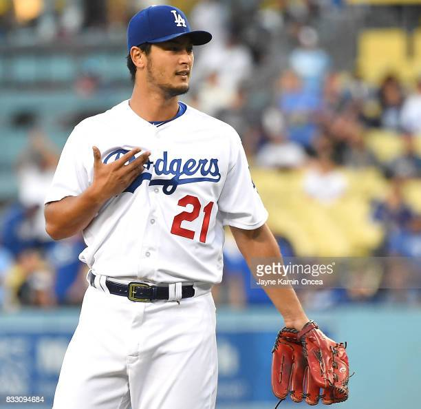 Yu Darvish of the Los Angeles Dodgers questions Austin Barnes of the Los Angeles Dodgers about the pitch after giving up a solo home run to Leury...