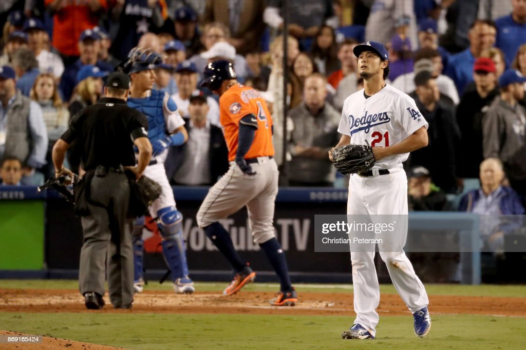 Yu Darvish #21 of the Los Angeles Dodgers reacts after George Springer #4 of the Houston Astros hit a two-run home run during the second inning in game seven of the 2017 World Series at Dodger Stadium on November 1, 2017 in Los Angeles, California.