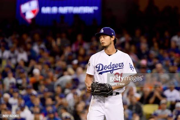 Yu Darvish of the Los Angeles Dodgers reacts during the second inning against the Houston Astros in game seven of the 2017 World Series at Dodger...