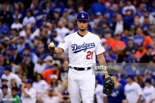 Yu Darvish of the Los Angeles Dodgers reacts in the first inning against the Houston Astros in game seven of the 2017 World Series at Dodger Stadium...