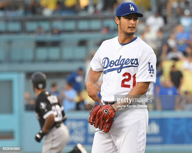 Yu Darvish of the Los Angeles Dodgers stands on the mound as Leury Garcia of the Chicago White Sox rounds the bases on a solo home run in the first...
