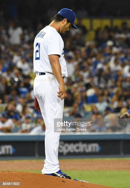 Yu Darvish of the Los Angeles Dodgers stands on the pitchers mound after giving up a home run in the game against the Chicago White Sox at Dodger...
