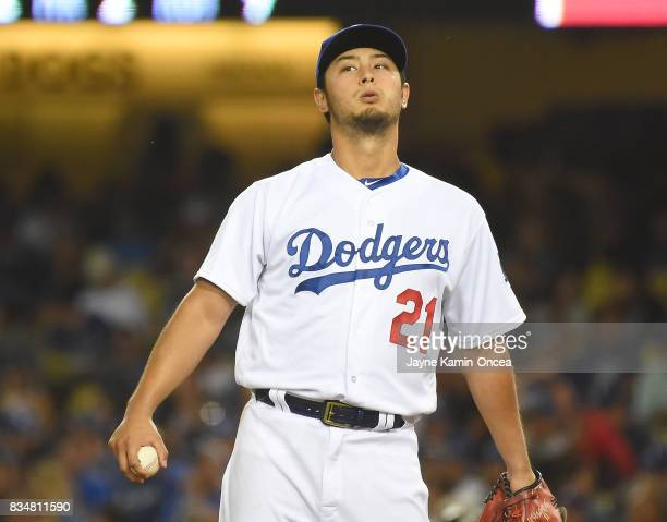 Yu Darvish of the Los Angeles Dodgers takes a deep breath on the mound during the game against the Chicago White Sox at Dodger Stadium on August 16...