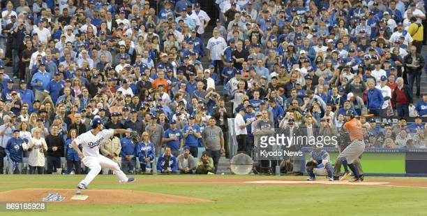 Yu Darvish of the Los Angeles Dodgers throws the first pitch in Game 7 of the World Series against the Houston Astros at Dodger Stadium on Nov 1 with...
