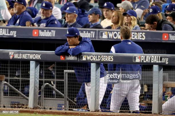 Yu Darvish of the Los Angeles Dodgers watches the eighth inning from the top step against the Houston Astros in game seven of the 2017 World Series...